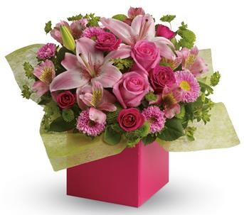 Called: Softest Whispers. Description: Any time is the perfect time to send a pink-me-up with this lush arrangement of lilies, roses and asters!