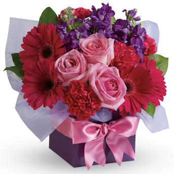 Called: Simply Stunning. Description: A stunning study in contrasts, this fabulously feminine arrangement mixes pale pink roses with hot pink gerberas and purple stock. A simple way to show you care!