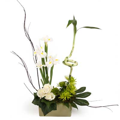Called: Singapore Sling. Description: A beautiful arrangement blending classic white with contemporary design.