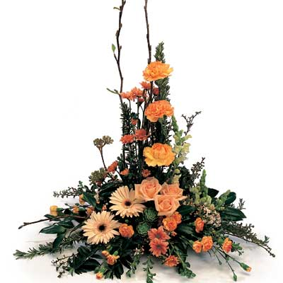 Called: Pimms. Description: This lovely arrangement is pretty favourites and greenery.