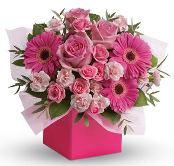 Called: Think Pink. Description: Looking to pamper someone special? Think pink! Hot pink gerbera mix with soft pink roses and mini carnations in this fabulously fun arrangement.