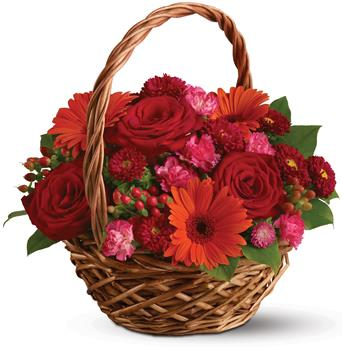 Called: Warm Wishes. Description: Rich red roses, pretty pink carnations and sunny orange gerberas make this basket a glorious, go-anywhere garden.