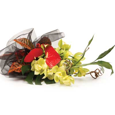 Called: A Touch of the Tropics. Description: This selection of exotic flowers will brighten up someones day.
