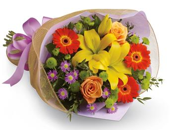 Called: Bright Lights. Description: A burst of brilliant flowers designed to make their spirits soar! This spectacularly colourful bouquet includes lilies, gerberas and roses.