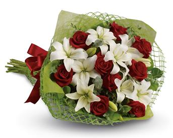 Called: Royal Romance. Description: Add some romance with this rich bouquet of luxurious red roses and white lilies.