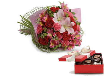 Called: From the Heart. Description: Tell someone you love them with this romantic bouquet which includes roses, lilies, alstroemeria and carnations.