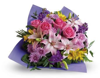 Called: Love and Laughter. Description: Contemporary yet classic, this bouquet includes an elegant mix of roses, lilies and alstroemeria.