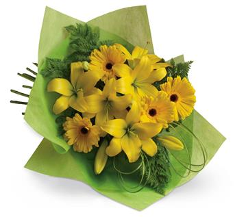 Called: Sunny Spot. Description: Pure sunshine! Send sunny thoughts to someone special with this bouquet of warm yellow lilies and bright gerberas.