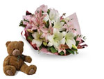 Lovely Lilies with a cuddly Teddy Bear