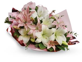 Called: Lovely Lilies. Description: Stunning in its simplicity, this innocent harmony of light pink roses and snow white lilies are a heartfelt way to send your very best.