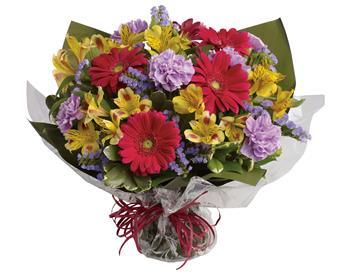 Called: Sweet Surprise. Description: Unexpected gifts are the best gifts! Send one they will never forget with this sweet bouquet of hot pink, yellow and purple blooms.