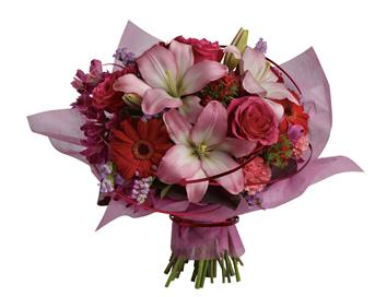 Called: City Chic. Description: This stylish array of roses, lilies and gerberas makes yours a sophisticated statement of affection.