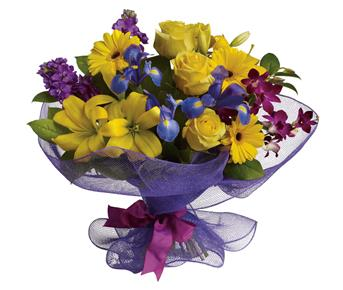 Called: Special Day. Description: Every day is a special day. Celebrate the beauty of life and love with this lush, lively mix of orchids, lilies, roses and gerberas.