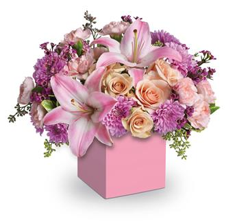 Called: Wonderful. Description: Perfectly peach spray roses, asiatic lilies, carnations and spray chrysanthemums fill this cute mini box.