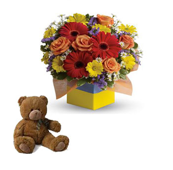 Called: Garden Spectacle. Description: You will want to put this colourful arrangement on your hit parade of gifts to send. Bold primary colours and a perfect mix of flowers make it great for everyone.