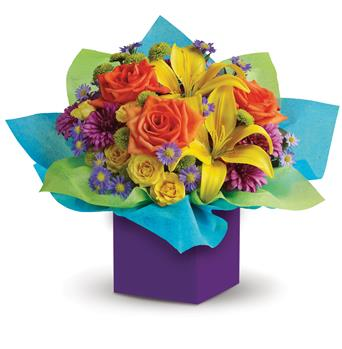 Called: Rainbow Surprise. Description: All the colours of the rainbow are present in this fabulous box arrangement. It is so bright, so brilliant and so unique, it will put anyone in the mood for celebrating!