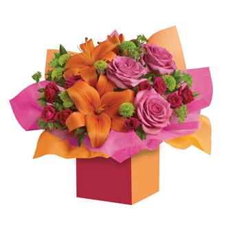 Called: Make a Wish. Description: Want to make someones birthday really rosy? This is the perfect arrangement. Colourful roses, fun flowers all wrapped up in a box that has Birthday wishes written all over it!
