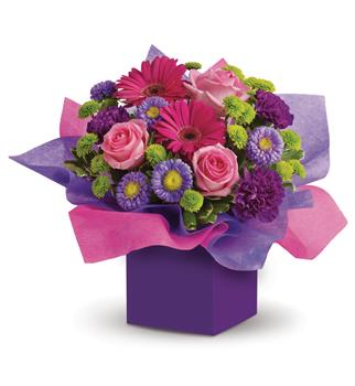 Called: Paradise. Description: If someone you know loves the colours pink and purple,this box arrangement will create a sensation! A flower arrangement designed to create instant happiness.