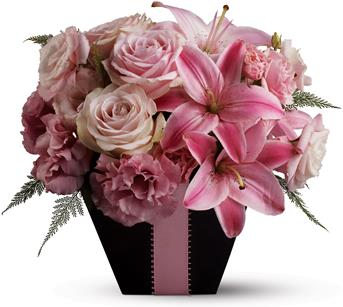 Called: First Blush. Description: Searching for a floral arrangement that is fabulous and flirty? Look no further than this blushing arrangement, created entirely from blossoms in pretty shades of pink and accented with a pink satin ribbon.