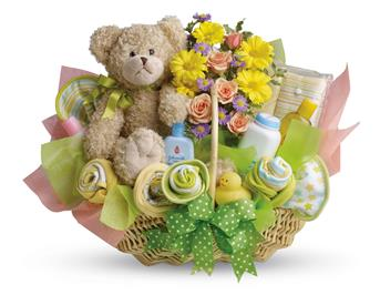 Called: New Baby. Description: Lucky bear! Make the new parents smile with this charming basket filled with flowers, assorted baby care essentials and a gorgeous teddy bear. Accented with a green satin ribbon, this thoughtful basket is sure to bring joy!