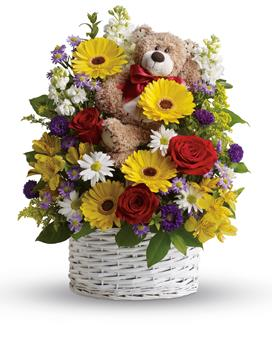 Called: Worldly Welcome. Description: Send this mixed arrangement of sweet white and yellow daisies, red roses, stock and adorable bear. Arriving with it, it is sure to bring lots of smiles.