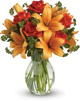Called: Fiery Beauty. Description: Spark someones attention by sending this absolutely radiant vase arrangement. Full of flowers and fiery beauty,it makes a beautiful gift for any occasion.
