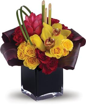 Called: Island Daydreams. Description: Island dreams can come true no matter where you are. This arrangement beautifully combines tropical flowers with greens and hand-delivers them in a dramatic cube.