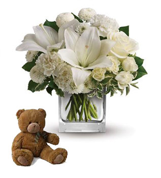 Called: Starlit Kisses. Description: Wish upon a star, but seal the deal with the pure white perfection of this luxurious cube arrangement. These fresh and fragrant flowers will make you the star of her heart!