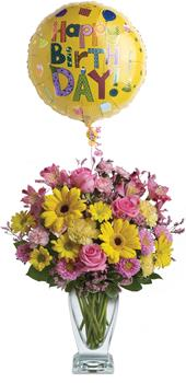 Called: Dazzle Her. Description: Dazzle someone on their special day with a stunning vase arrangement. Delightful blossoms and balloon are sure to make their day!