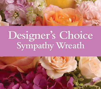 Called: Sympathy Wreath. Description: Can not decide on what to send? The Designers Choice Sympathy Wreath is a one-of-a-kind collection of the designers freshest flowers.