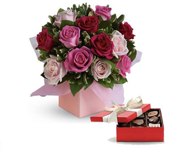 Called: Blushing Roses. Description: Sing her a love song - with roses. This lush red and pink rose arrangement tells her just how much you care.