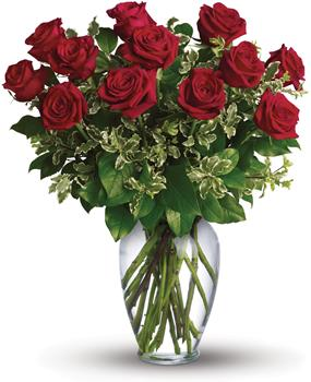 Called: On My Mind. Description: Stunning in its simplicity, this elegant vase arrangement of deep red roses and rich green foliage makes quite an impression.