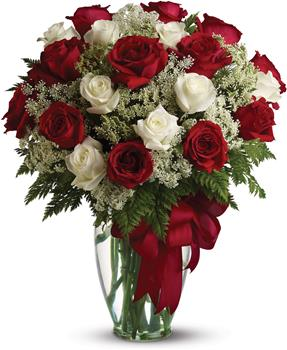 Called: Love is Divine. Description: Loves divine, and roses are too. This beautiful vase arrangement of red and white roses is a timeless gift for your beloved.