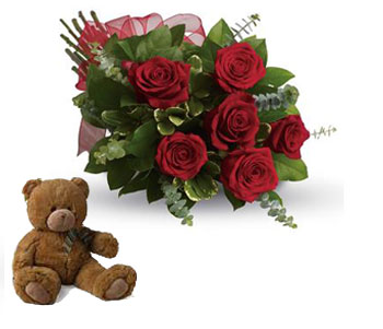 Called: Fall in Love. Description: They will fall in love with you all over again when you surprise them with this perfectly petite bouquet of six sensational roses amidst beautiful fresh greens.