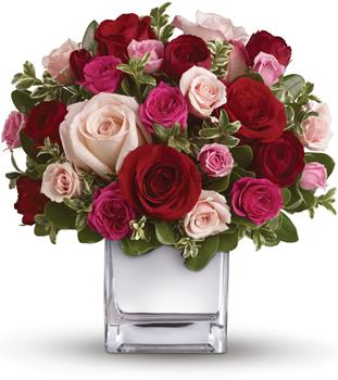Called: Lovely Melody. Description: Their heart will break into song when this romantic cube of ravishing roses arrive! A symphony of size and shade, this red and pink present will hold their heart forever.