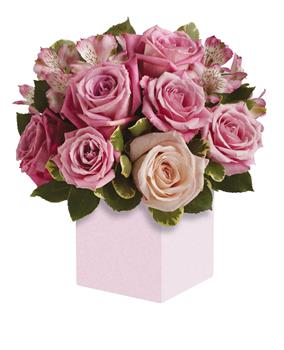 Called: Indulgence. Description: Exquisite rose box arrangement featuring soft, romantic shades of pink. A versatile choice for an anniversary or anytime you want to send your very best.