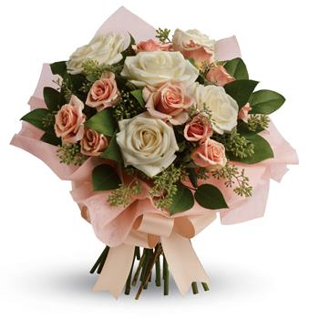 Called: Just Peachy. Description: A fresh, feminine spin on the classic rose bouquet, this creamy mix of peach and cream roses is the ultimate in romance.