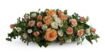 Called: Table of Love. Description: Set the scene for romance with this lavish table arrangement of peach, pink and cream roses. Beautiful on an entry table, too!