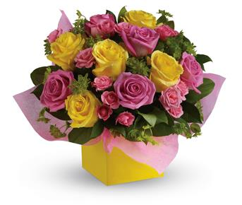 Called: Rosy Sunshine. Description: This stunning arrangement of pink and yellow roses adds an instant smile to anyones face.