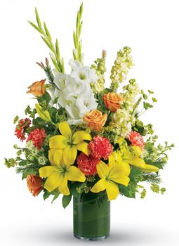 Called: Fond Farewell. Description: Create a bright, heart-warming tribute to the special person who lit up everyones lives. Send a stunning leaf lined vase arrangement of golden lilies, white gladiolus and peach roses.