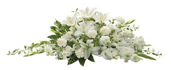 Called: Bountiful Memories. Description: The purity of this all-white casket spray creates an aura of serenity and peace. A beautifully memorable final farewell to a lost loved one.