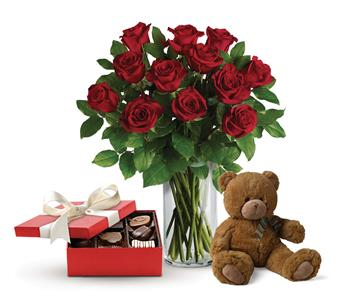 Called: Beautiful Love. Description: This lavish gift set includes a gorgeous vase arrangement of twelve long stem red roses, accented with greenery, plus chocolates and a delightful bear.