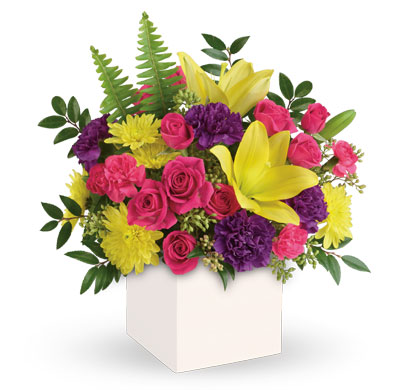 Called: Vivid Delights. Description: Colour their day happy with this bright surprise! Artfully arranged, this sunny bouquet of yellow lilies and hot pink roses celebrates them in style.