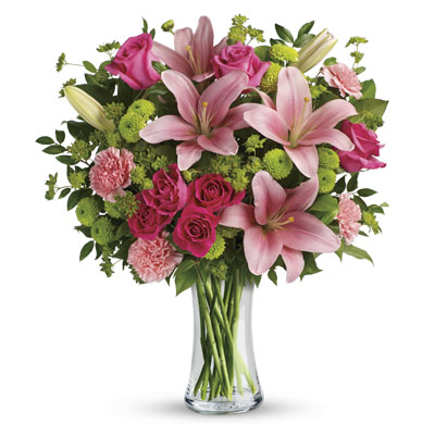 Called: Junoesque. Description: What's better than pink? More pink! Lavish your loved one with this blissful bouquet of roses and lilies, hand-delivered in a classic glass vase. It's an impressive gift that promises to put some pink in her cheeks!